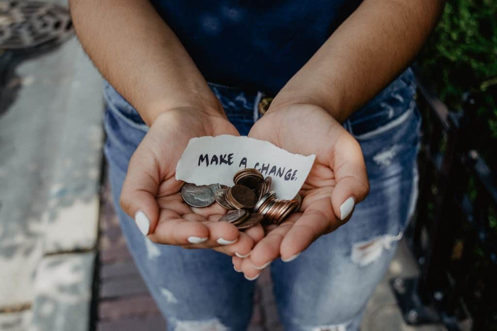 This is an image of a woman with change in her hands.